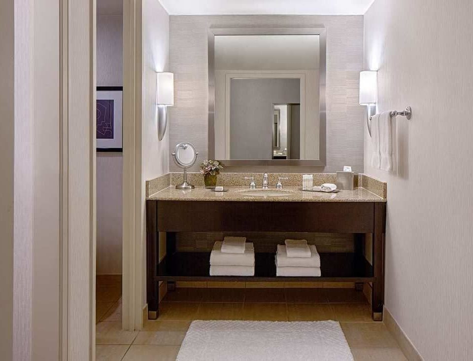 bathroom mirror property sink cabinetry home flooring Suite hall plumbing fixture