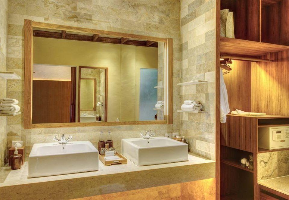 bathroom sink mirror property cabinetry home Suite toilet flooring tan