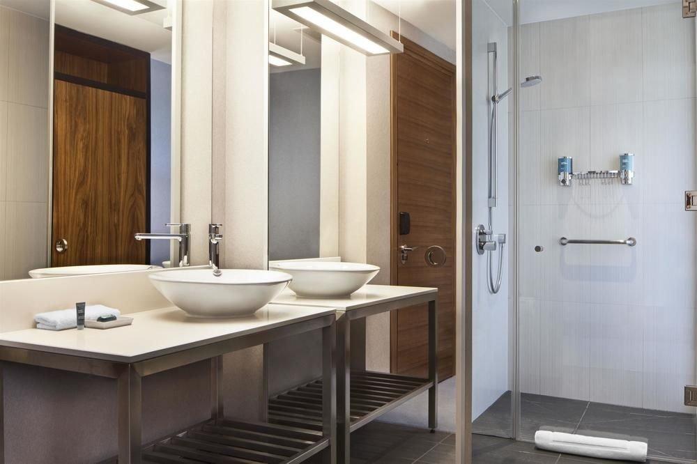 bathroom sink mirror property scene plumbing fixture Suite home flooring cabinetry toilet rack tan