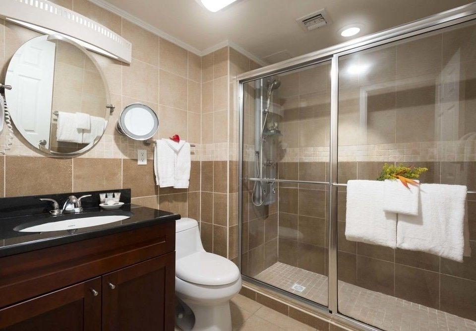 bathroom toilet property sink home Suite cabinetry tile tiled