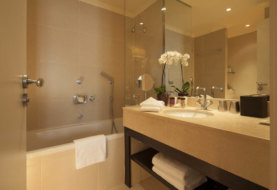 bathroom mirror sink property home Suite cabinetry plumbing fixture toilet tan