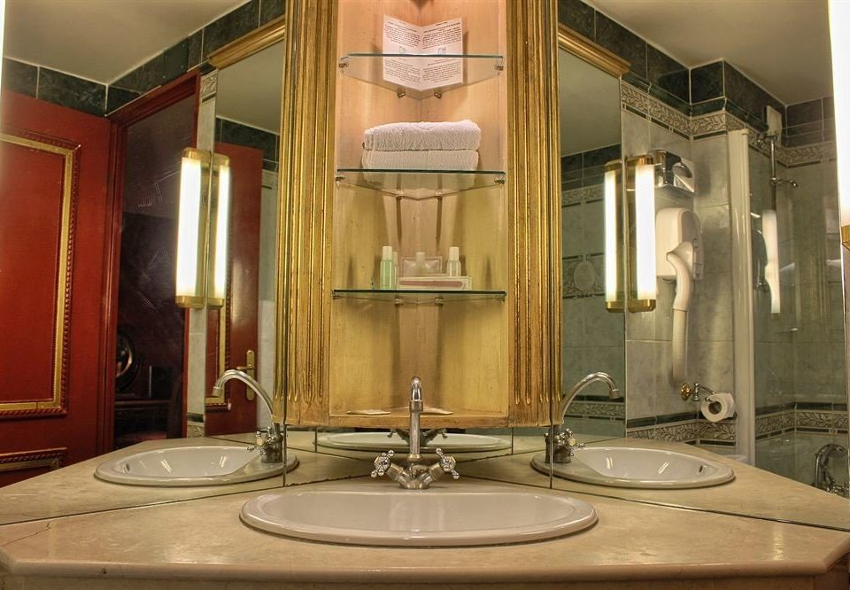 bathroom sink mirror property toilet home mansion lighting cabinetry Suite water basin