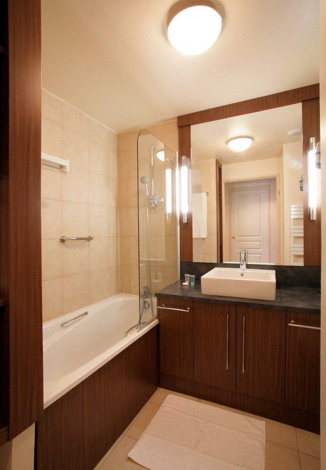 bathroom mirror property sink cabinetry home plumbing fixture Suite tile