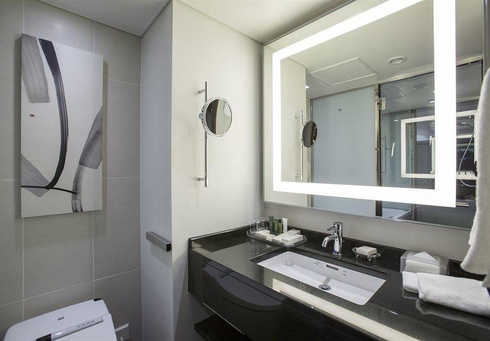 bathroom sink mirror property home condominium Suite toilet clean