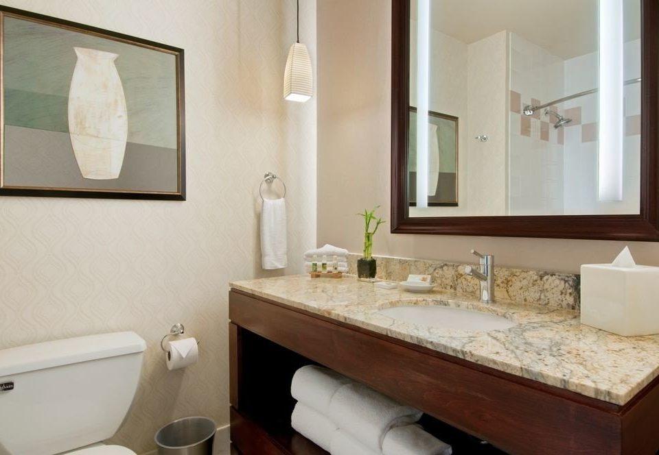 bathroom mirror sink property toilet home Suite plumbing fixture cottage clean tan