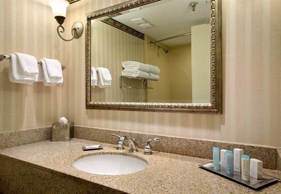 bathroom sink mirror property towel Suite home vanity counter flooring double swimming pool clean rack