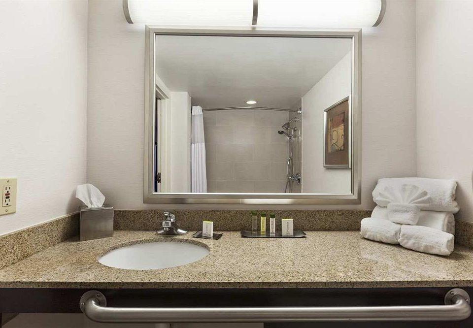 bathroom sink mirror property towel home Suite living room flooring toilet clean tan