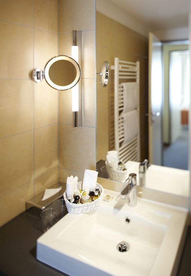 bathroom sink mirror property toilet home Suite plumbing fixture clean tile