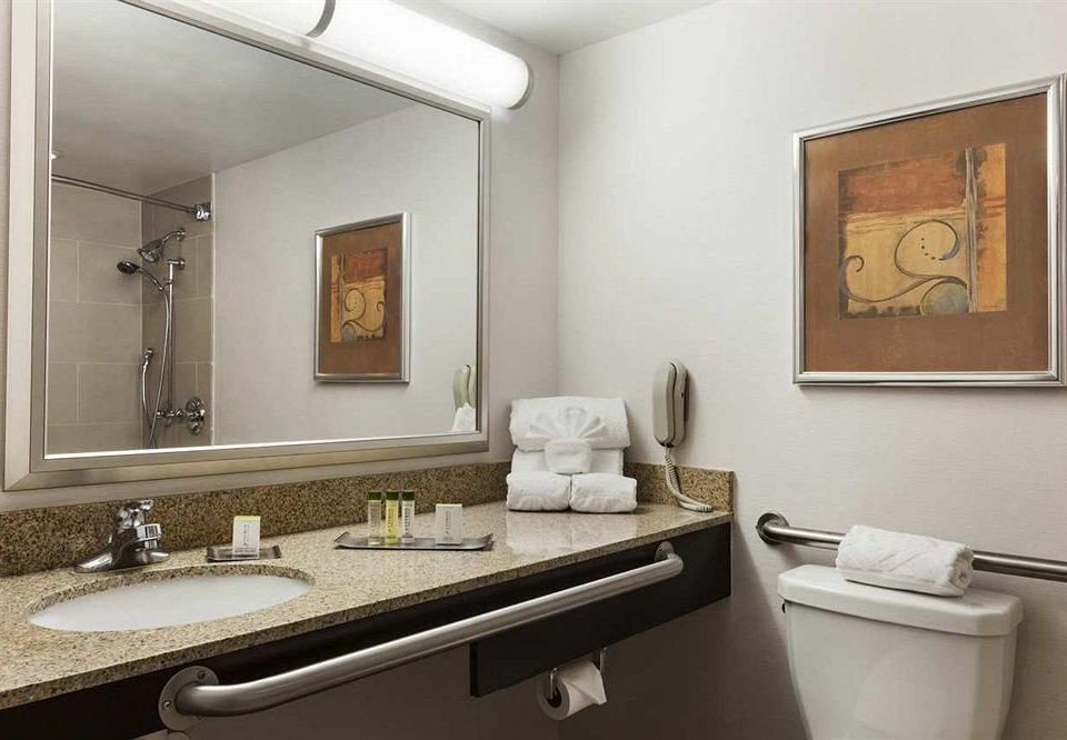 bathroom mirror sink property home Suite living room towel rack clean
