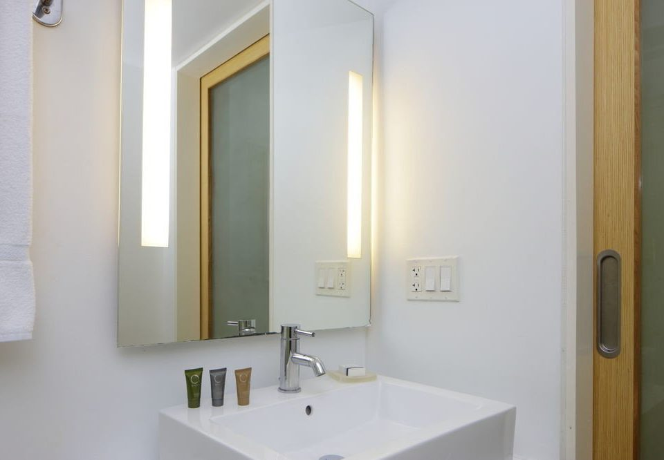 bathroom mirror sink property white plumbing fixture Suite clean