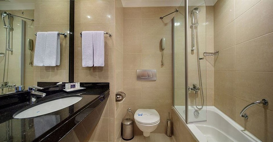 bathroom sink toilet property mirror plumbing fixture public toilet Suite public tile clean water basin tiled