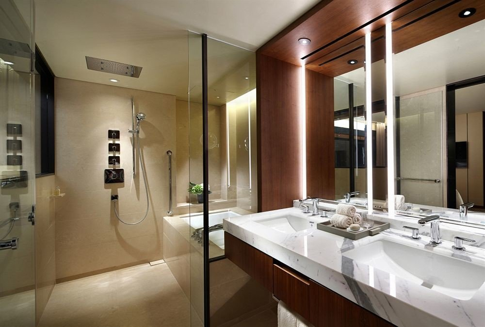bathroom sink mirror property counter toilet lighting home Suite condominium long tile