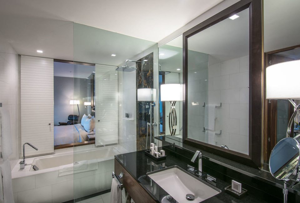 bathroom mirror sink property condominium home counter Suite living room kitchen appliance stove