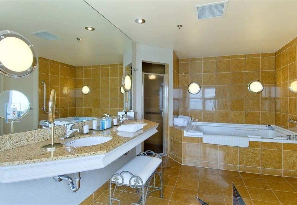 bathroom sink mirror property home Suite flooring condominium swimming pool