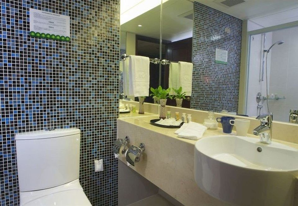 bathroom sink property toilet condominium home Suite flooring tile tiled