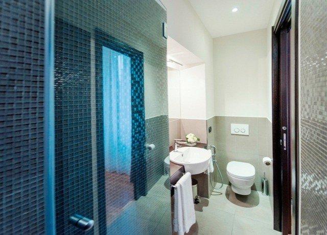 bathroom toilet property shower sink Suite plumbing fixture public toilet condominium tiled stall tile