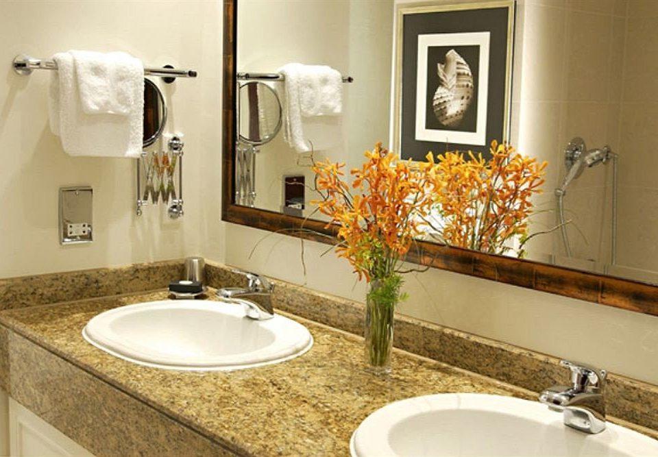 bathroom sink mirror property counter countertop toilet home Suite flooring plumbing fixture vanity cottage water basin
