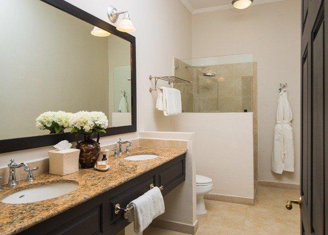 bathroom mirror sink property vanity towel home cottage counter flooring Suite countertop rack