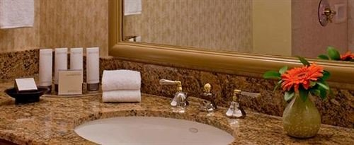 bathroom sink property Suite swimming pool countertop home cottage flooring dining table