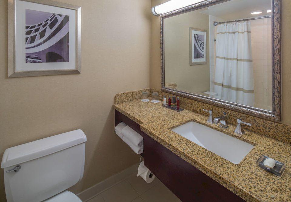 bathroom mirror sink property toilet home cottage Suite flooring rack tile tan tiled