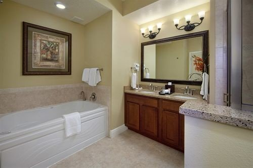 bathroom property sink mirror home hardwood cottage Suite mansion flooring tan