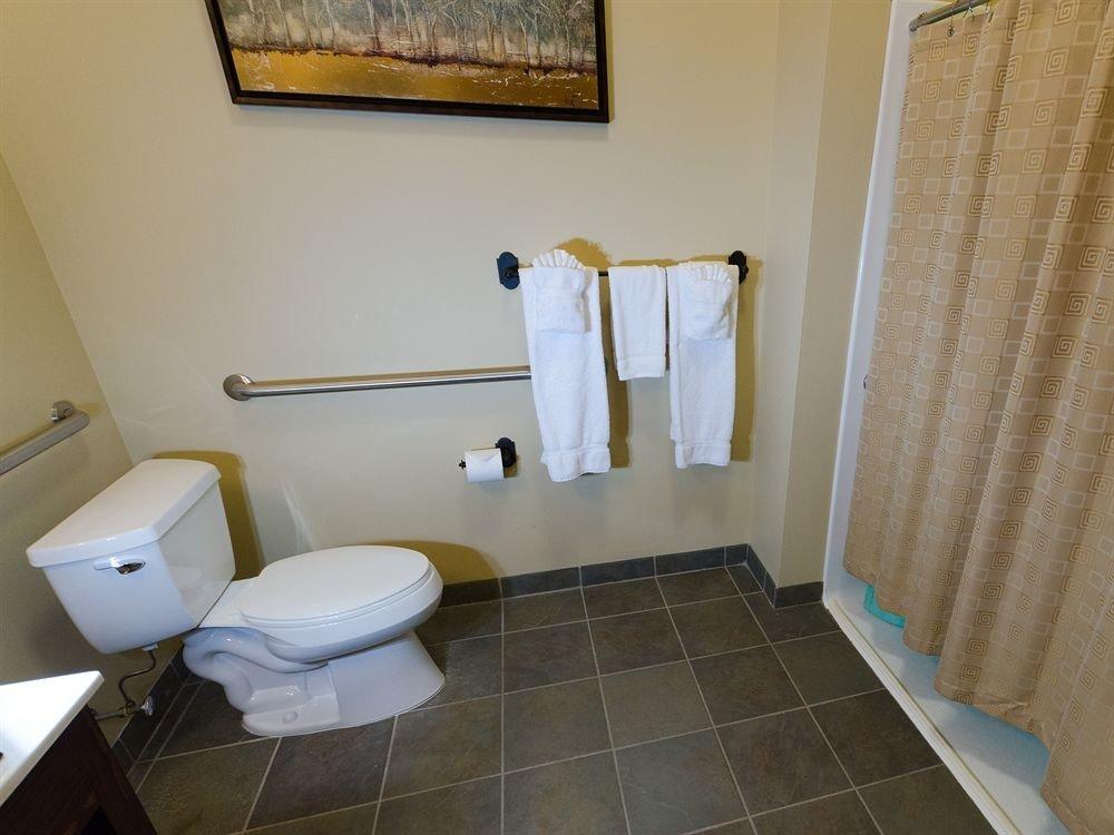 bathroom property house home flooring sink plumbing fixture cottage Suite tiled tile