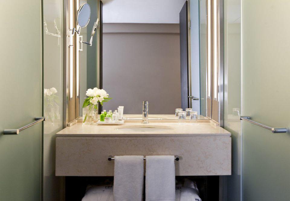 bathroom mirror sink property house home Suite plumbing fixture cottage toilet flooring tan