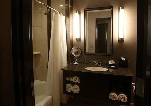bathroom mirror property sink home Suite lighting cottage light