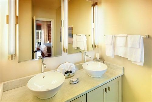 bathroom sink mirror property toilet home Suite cottage tan