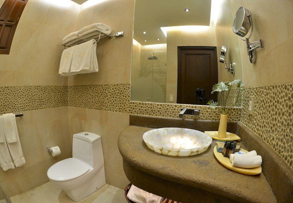 bathroom property sink toilet Suite home towel cottage tan rack