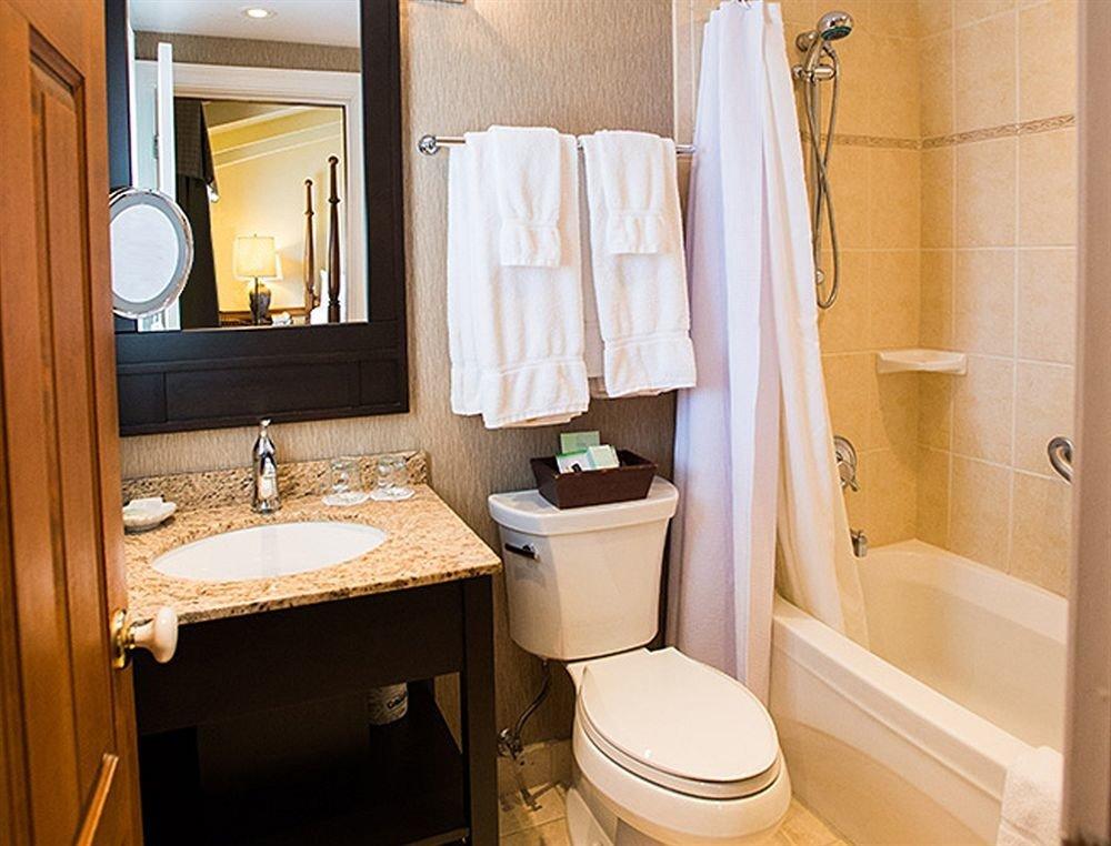 bathroom toilet sink towel home Suite cottage plumbing fixture rack tan