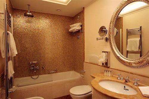 bathroom sink mirror toilet property Suite towel plumbing fixture cottage tan
