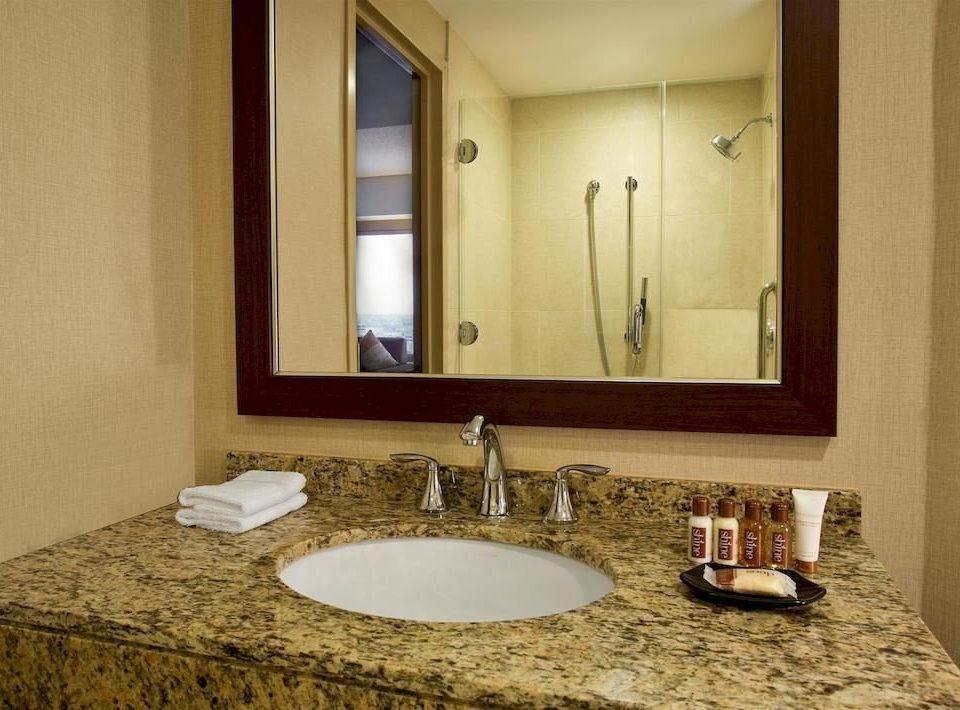 bathroom sink mirror property vanity towel countertop hardwood home flooring Suite material plumbing fixture counter