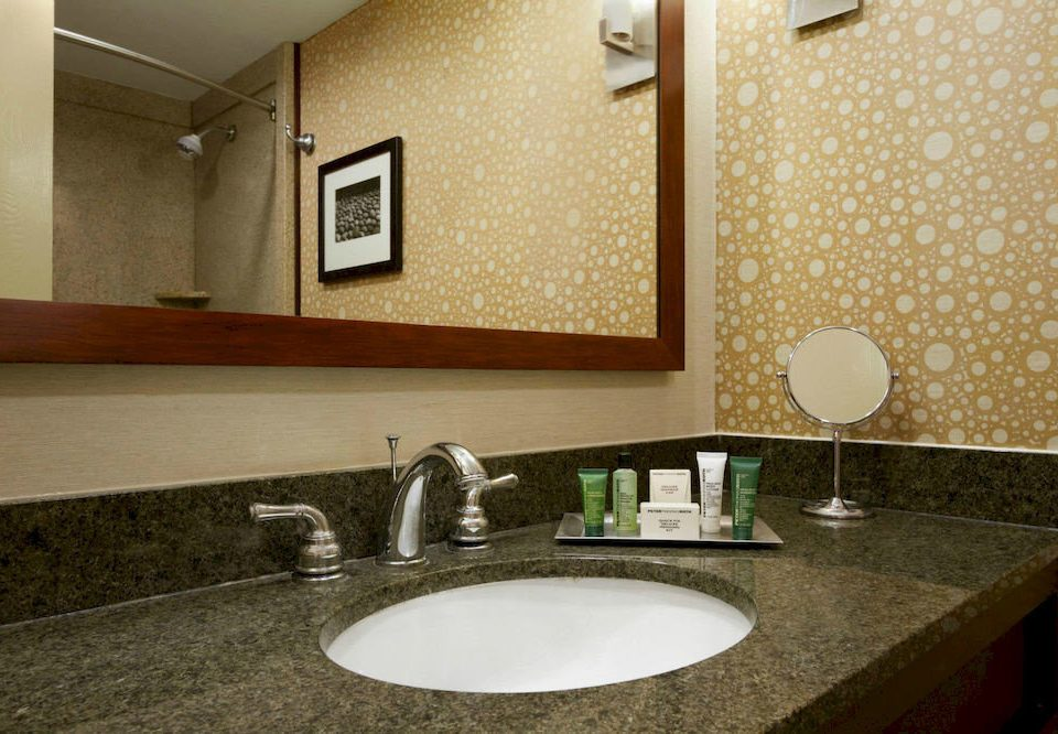 bathroom sink mirror property countertop counter home Suite flooring vanity tile plumbing fixture material