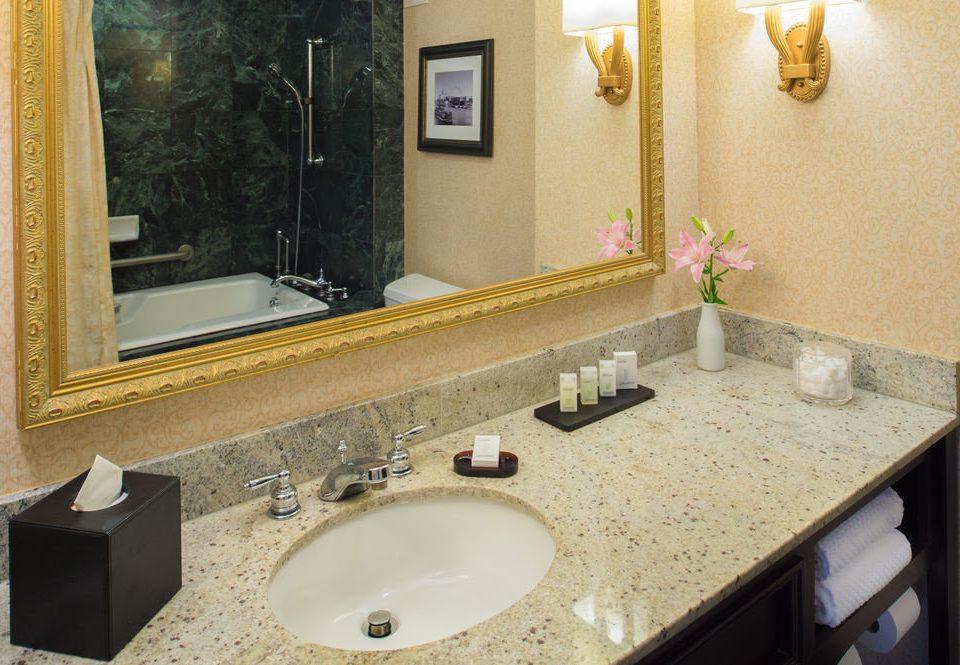 bathroom sink mirror property toilet countertop counter flooring home Suite towel double tile vanity plumbing fixture material