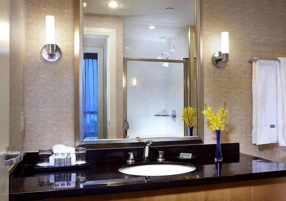 bathroom sink mirror property counter countertop home lighting Suite plumbing fixture glass toilet