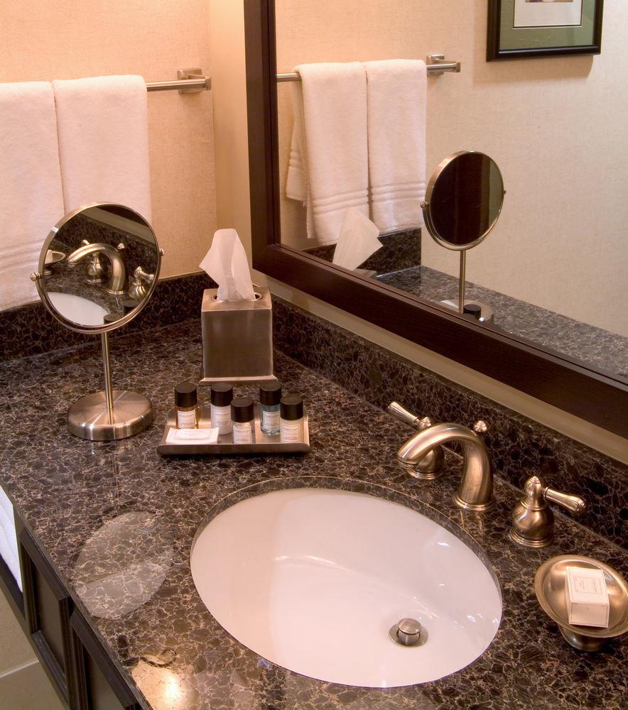 bathroom sink counter mirror countertop property home flooring toilet material Suite