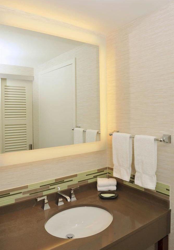 bathroom mirror sink property toilet home Suite flooring counter plumbing fixture