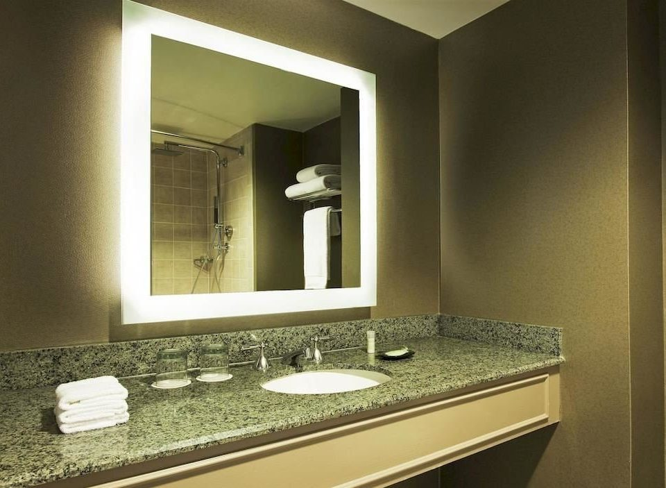 bathroom mirror sink property vanity counter home lighting towel Suite public
