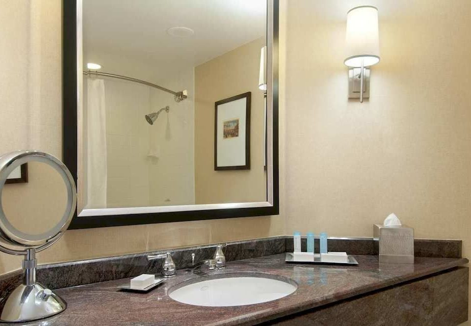 bathroom mirror sink property Suite home lighting counter plumbing fixture toilet