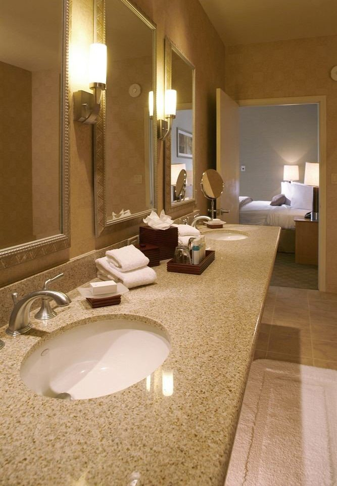 bathroom mirror sink property Suite home flooring swimming pool countertop