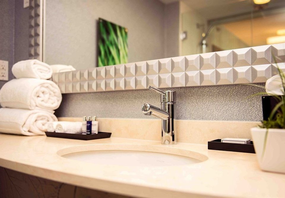 property bathroom sofa countertop home flooring sink Suite seat tile living room plumbing fixture