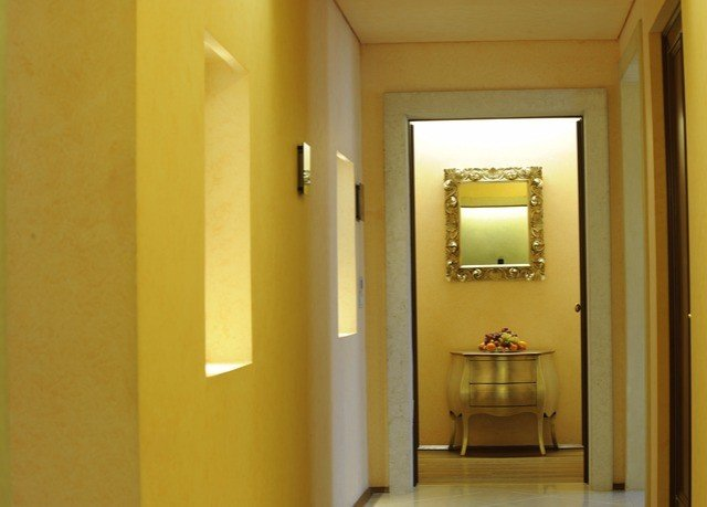 bathroom mirror property yellow sink hall home lighting door Suite painted