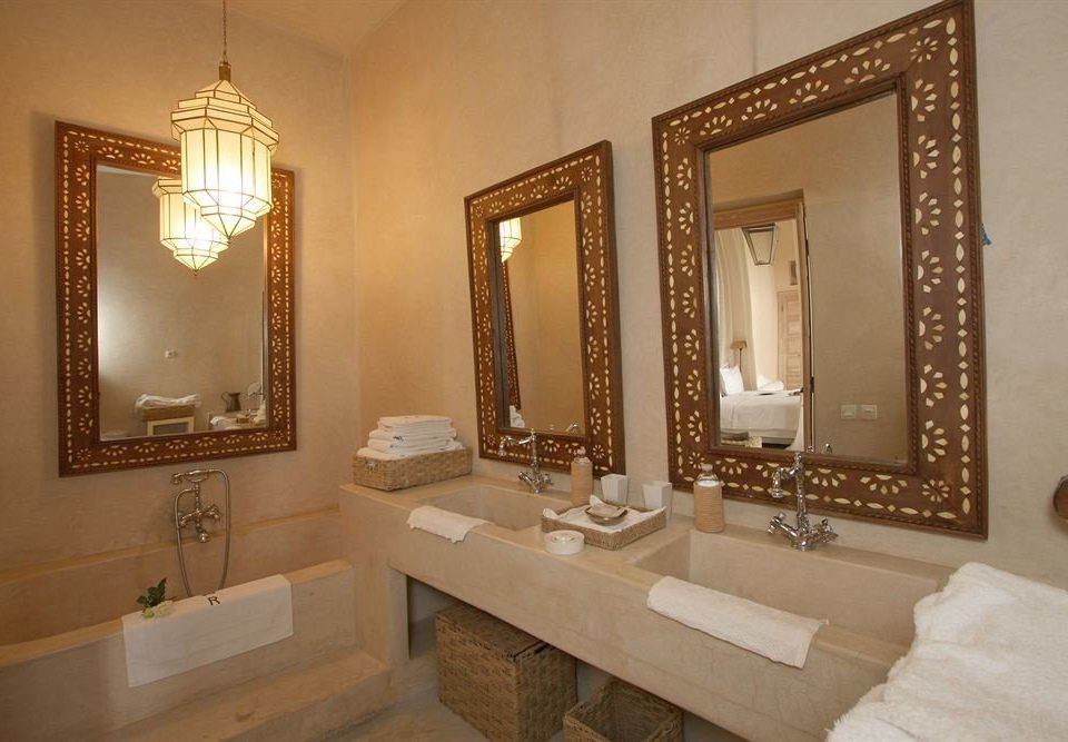 bathroom mirror sink property vanity double Suite home towel mansion tile fancy tub stone tiled