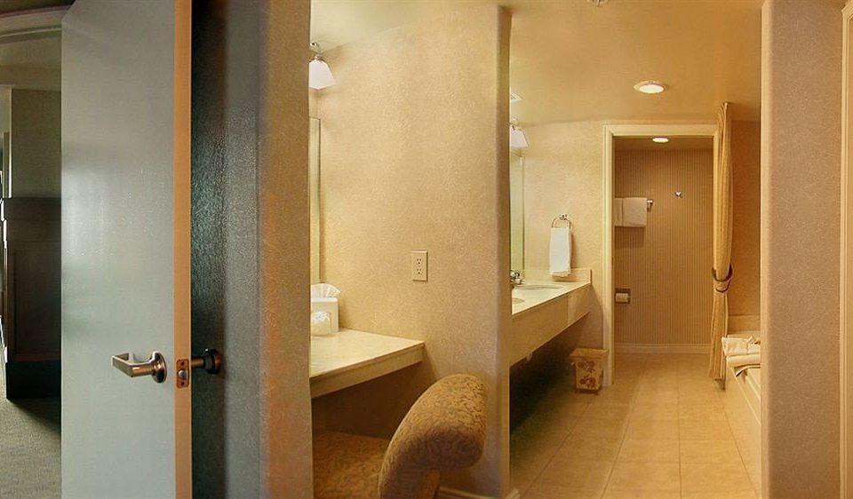 bathroom mirror sink property Suite home towel flooring tan