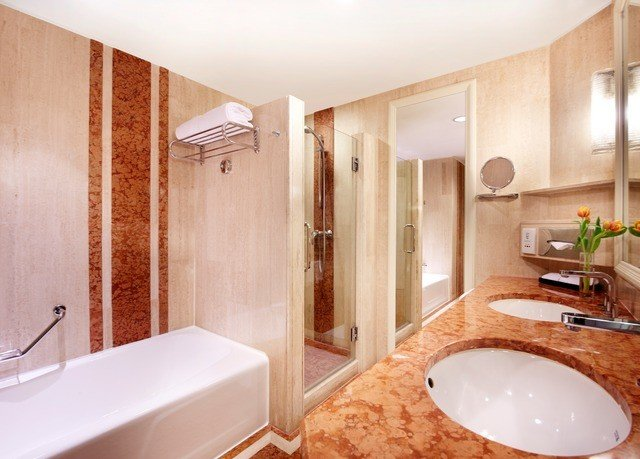 bathroom property sink toilet home Suite flooring tile interior designer
