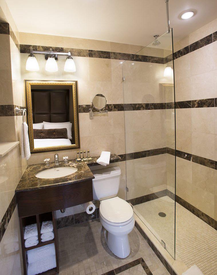 bathroom toilet property sink home Suite flooring tiled tan