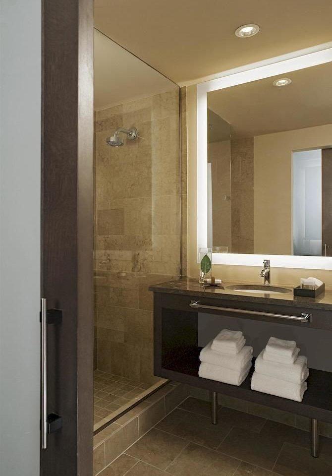 bathroom mirror sink property house home plumbing fixture Suite vanity flooring tile