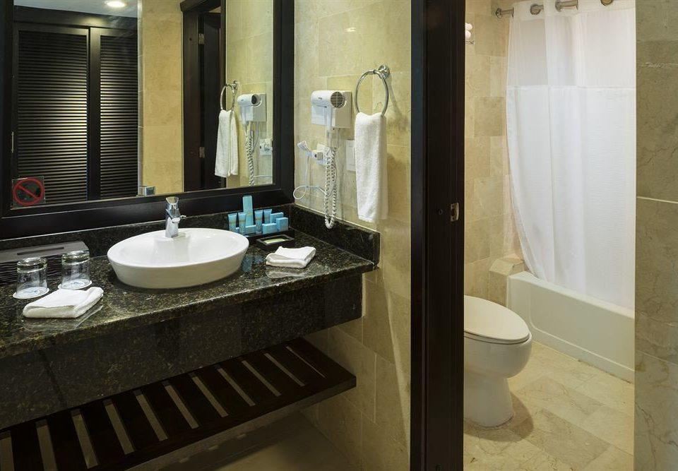 bathroom sink mirror property toilet home Suite plumbing fixture flooring public