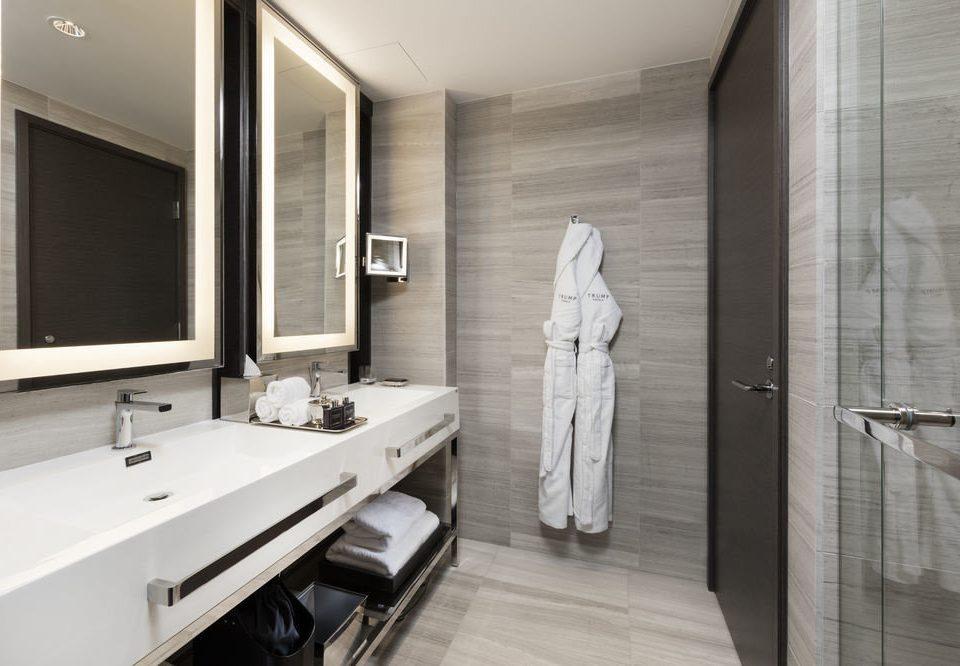 bathroom sink mirror property plumbing fixture home flooring Suite public toilet toilet